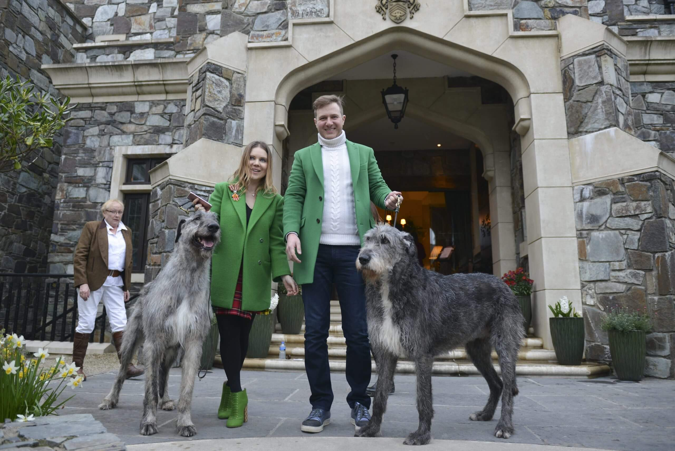 Couple With Green Jackets with Dogs'